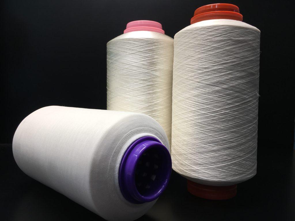 Foto: Rocche di filo di acetato ritorto su tubetto forato per tintoria e calzina